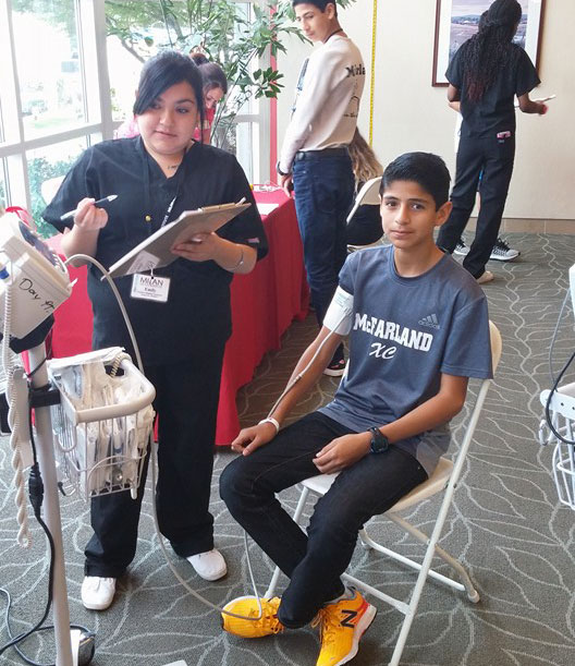 Student getting blood pressure checked